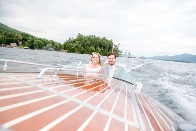 streamlined view of newlyweds in speed boat
