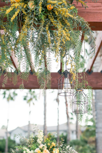 wire frame lightbulb hangs from arbor