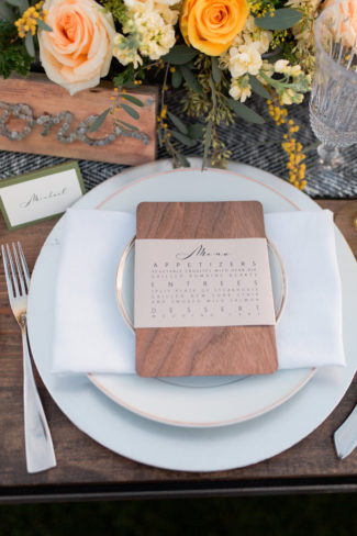 wood stationery menu on place setting