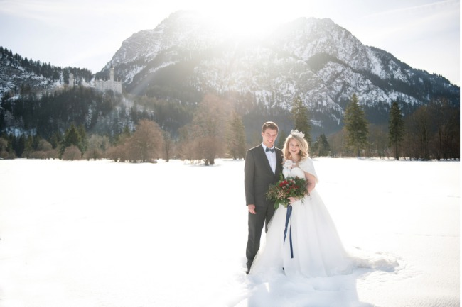 Couple on snow with Neuschwanstein Castle background