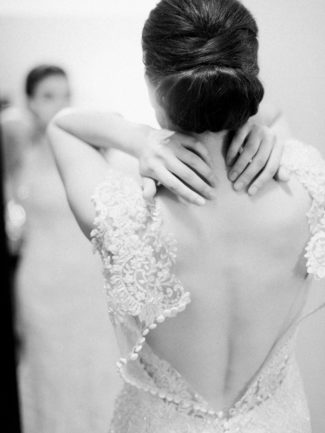 black and white photo bride in backless gown