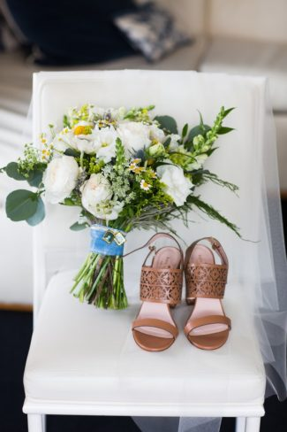 bouquet and shoes on chair