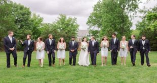 bridal party in a row on grass