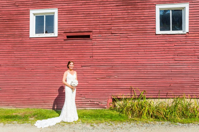 bride next to red barn side