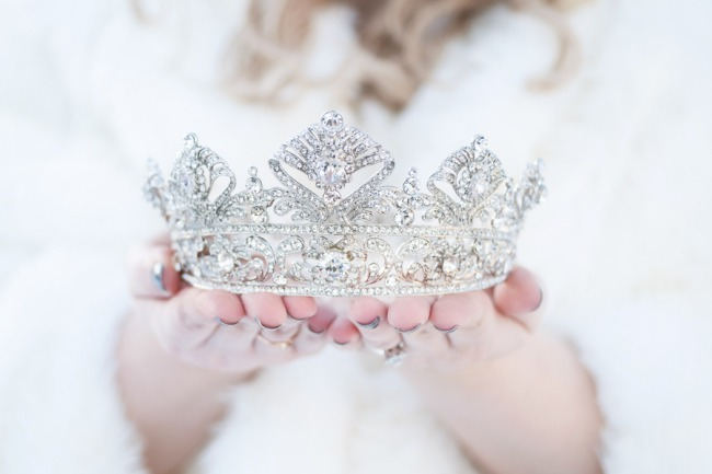 bride with crown in both hands