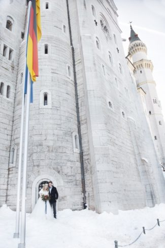 closeup of Neuschwanstein Castle with flag