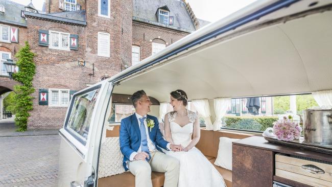 couple in back of vintage VW van