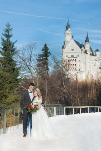 couple with Neuschwanstein Castle in background