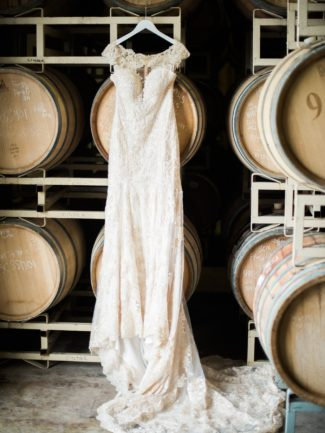 dress hangs in wine barrel cellar
