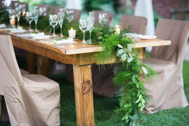 foliage hangs over wooden table