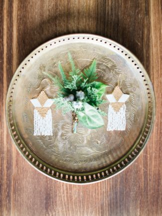 gold plate with decor and greenery boutonniere