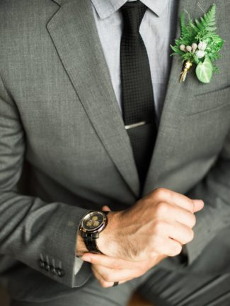 groom adjusting watch