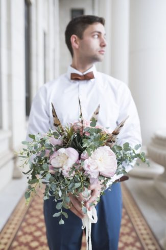 husband holding bouquet