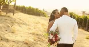 newlyweds among vines at Meritage vineyard