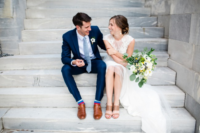 newlyweds on steps of The Powel House