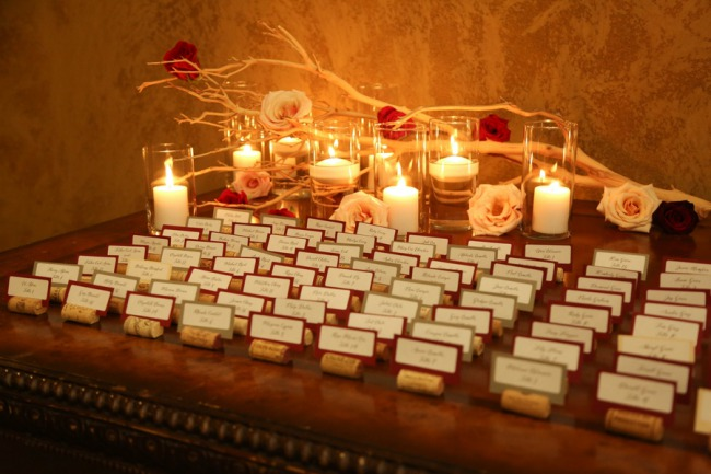 place cards on table with real candles