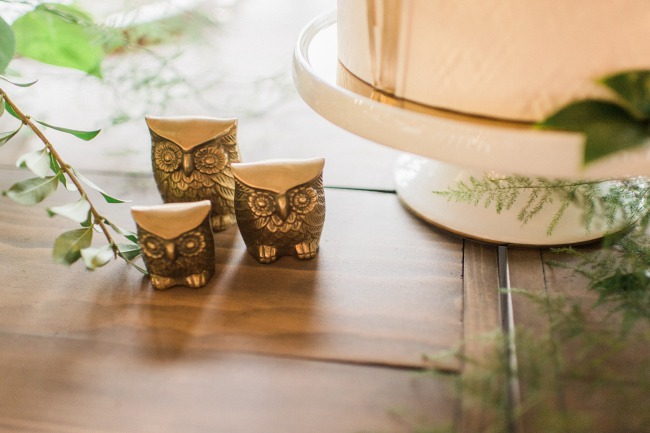 three gold figurine owls