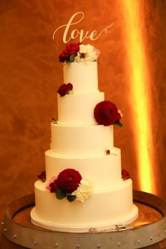 tiered cake with LOVE topper