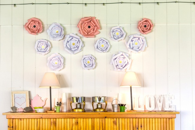 wall decorated with giant paper flowers