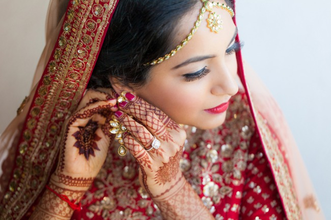 Indian bride wearing gold jewelry