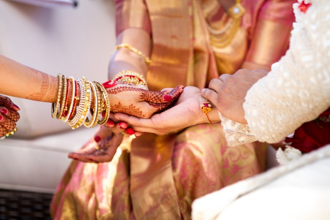 Indian wedding ceremony holding hands