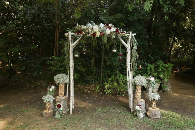arbor in the woods with decor