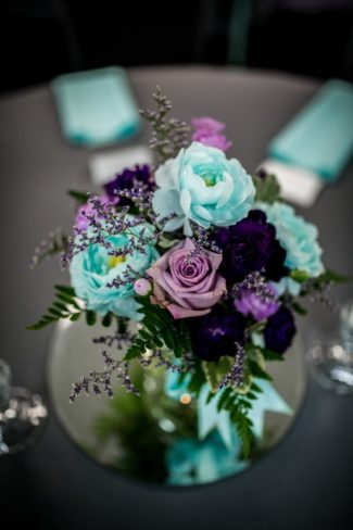 blue and violet floral centerpiece