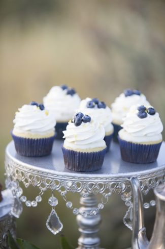 blueberry topped cupcakes on vintage stand