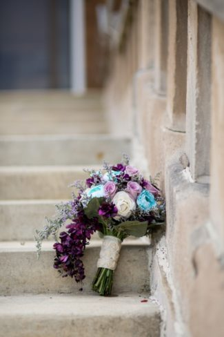 bouquet resting on stairs