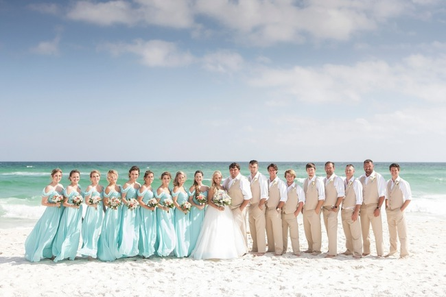 bridal party lined up on beach