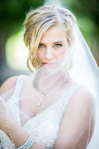 bride behind pearl edged veil