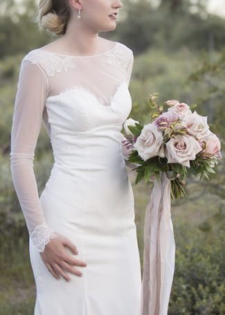 bride holding bouquet by Posies Florals