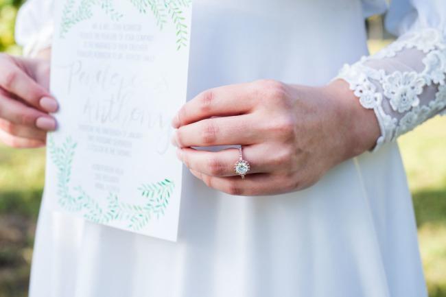 bride holds invite