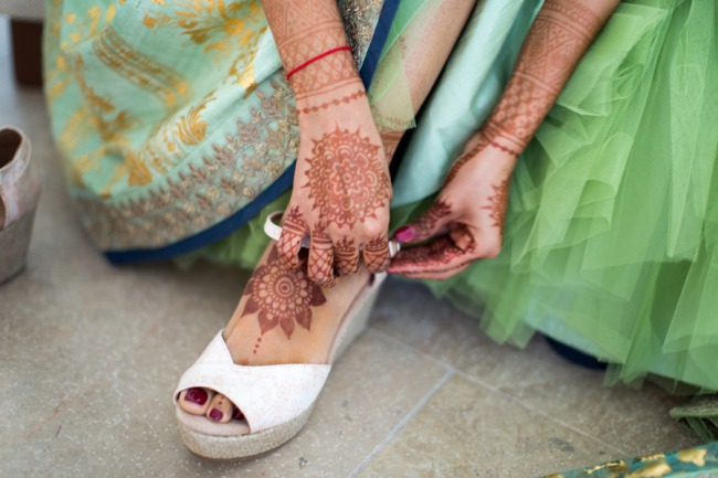 bride with ankle and hand hennah tattoo