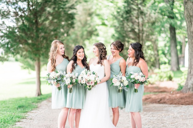 bridesmaids in light sage dresses