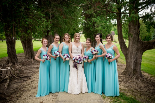 bridesmaids in robins egg blue dresses