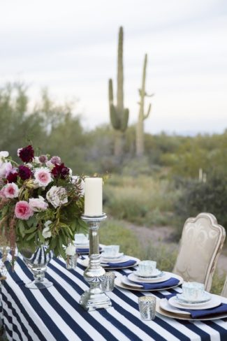 decor on striped tablecloth in desert