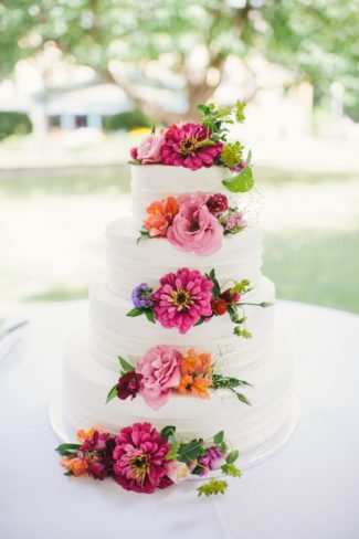 four tier cake with bright wildflowers