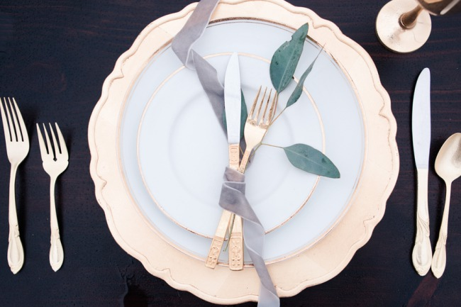 gold cutlery on gold rimmed plates