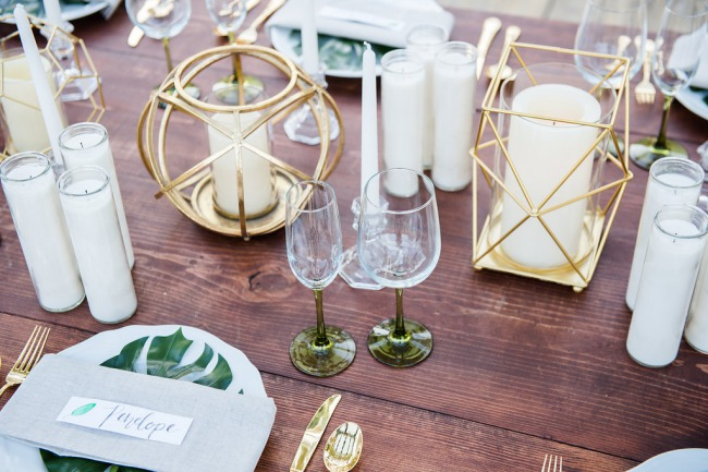 gold geometric holders on table