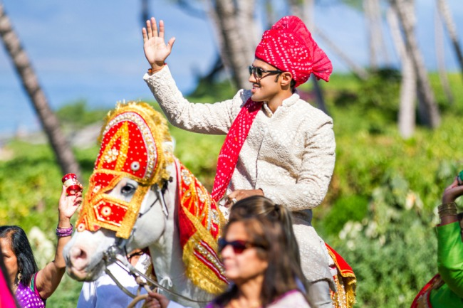 groom riding on horse