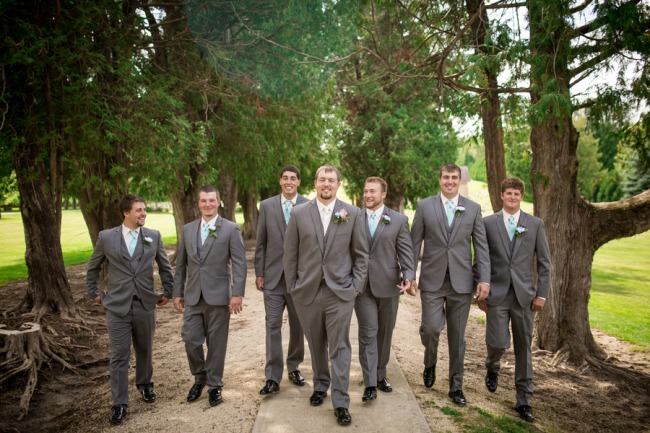 groomsmen and groom in gray suits