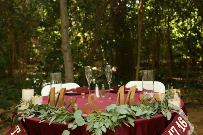 head table with giant Mr and Mrs sign
