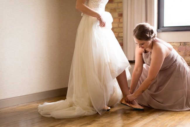 helping bride put on Tieks shoes