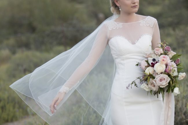holding out bridal veil length