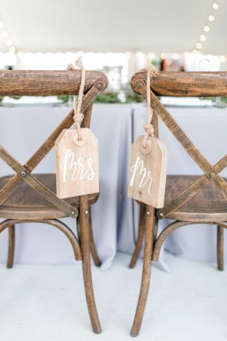 mr and mrs sign on chairs