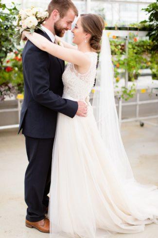 newlyweds hug