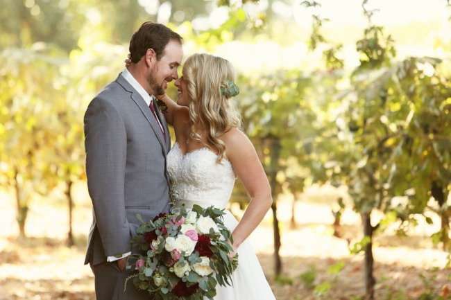 newlyweds in vineyards at Gale Winery