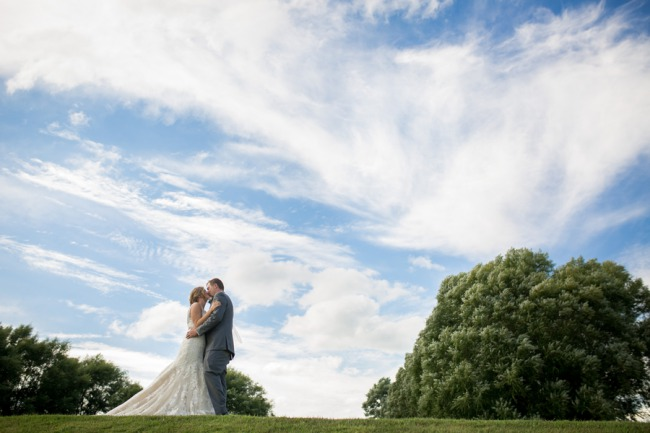 newlyweds with sky background