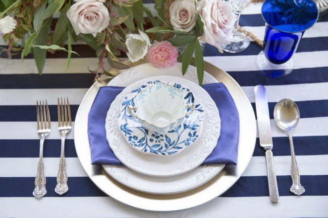 place setting with teacup on plate